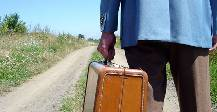 Man with suitcase leaving home
